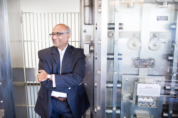 photo of Ash Patel in front of a vault